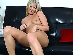 Long haired young blonde amateur Cayla Lyons with small boobs and long legs gets naked at the interview and polishes shaved cunny in provocative position on leather couch.
