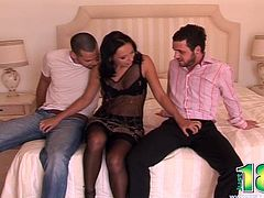 Horny brunette, Sonia Red, wearing stockings is having fun with two men indoors. She sucks and rubs the guys' shafts and enjoys sex in the cowgirl position and doggy style.