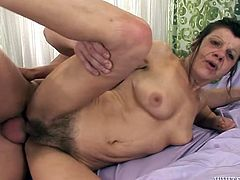 Kinky and perverted granny with hairy pussy seduces a young dude with big cock. Then she gets her snatch pounded hard from behind.