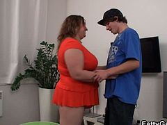 This is a highly special mission for a special fat slut! Get it on with some RNB dude, we told her. Not only she's fat and sexy, she's also smart. Check out what she did: she found a dancing studio, met this young shy dude and totally charmed him. A few compliments followed by a 'teach me, stud' request totally did it. Watch the guy literally fall for her while feeling up her tits and poking her tight wet fat pussy. He had quite a load there, and every drop of it ended up on her giant natural rack.