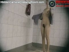 Hidden Camera Dressing Room brings you a hell of a free porn video where you can see how a hidden camera shows a hot brunette after the shower drying her body.