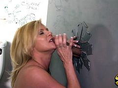 Get a boner watching this blonde MILF, with big boobs wearing a cute bra, while she goes hardcore with a black guy she doesn't see or know.