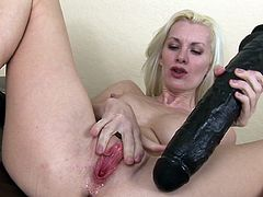 Slim with naughty thoughts in her mind, blondie stretches her pink pussy with a massive toy cock