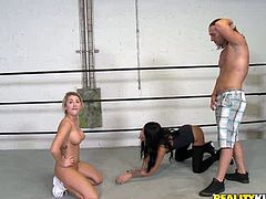 Two craving for cum chicks give eager blowjob to one horny guy right in the ring. They are ready to polish his better half till the happy end.