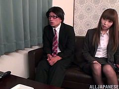 Nasty Japanese chick wearing a blouse and skirt is having fun with some dude in an office. They make out and pet each other and then bang in reverse cowgirl position.