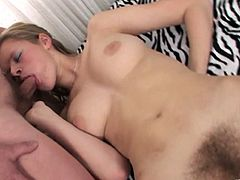 A playful teen with a bushy pussy gives a blowjob to some dude in a bedroom. Then she lies down on a bed and gets fucked intensively.