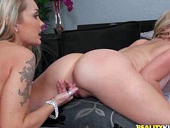 Killer beauties Brianna and Ray Devon scissor their legs pushing against each other's wet pussies. Then one of the hotties sticks her tongue to her lover's punani tickling her fancy.