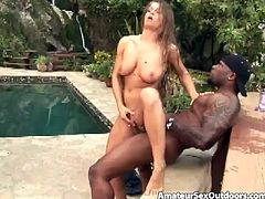 Have a blast watching this brunette, with immense breasts and a shaved cunt, while she goes hardcore with a black dude next to a pool.