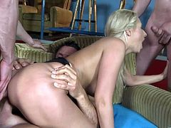 A blonde fuckin' bitch sucks on a bunch of cocks and gets fucked hard, check it out right here, it's a sweet ass gangbang!