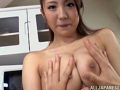 This Japanese lady has a massive pair of breasts, and she want to show them off to everyone. She takes off her shirt and lets her man grab a handful of them. Watch as he licks her nipples like a creepy pervert.