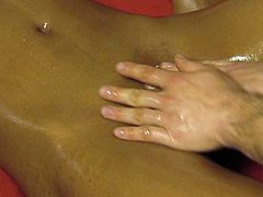 He strokes her slender body and oils up her pussy. Then his playful fingers penetrate her slit and make her moan with pleasure.