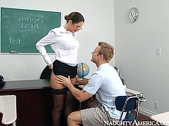 Curvy milfie Babe Jayne looks mean. But bad student boy makes her horny. Babe Jayne sits on table and spreads her gorgeous legs ordering her college stud to lick her moist pussy as a punishment.