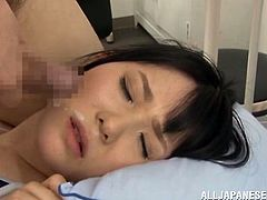 Nasty Japanese chick Rin Suzune wearing a swimsuit is getting naughty with a guy indoors. She massages his wang passionately and also rubs it against her pussy.