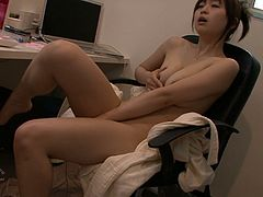 Japanese brunette girl with gorgeous curves Nozomi Hazuki sits on chair completely naked. Curvy cutie strokes her big tits with big vibrator and pets her meaty hairy pussy with that sex toy as well.