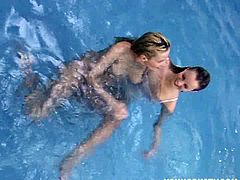 These two blonde teens fool around in the swimming pool. The real fun begins when they get out and start toying each others twats with a vibrator. They are both busty.