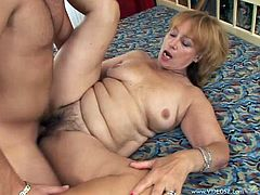 Get a load of this hot scene where this horny mature blonde is fucked silly by this guy as you hear her moan until her pussy's filled by semen.