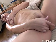 This sexy and chubby Japanese slut is so horny that she cannot wait to masturbate for the cameras. She pulls down her pants and plays with her sweet pussy. She is so dripping wet now, and she is desperately in need of a cock. Can you help her?