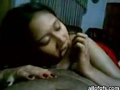 This slutty Indian brunette has fun with the cock of her dude sucking it. Have a look at this bitch in The Indian Porn sex video.