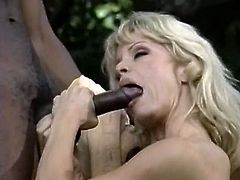 Watch this slutty and kinky white bitch with large titties sucking that large cock of her new friend in The Classic Porn sex clips.
