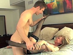 Nina Hartley is a pro, that shows this young stud how to fuck a pussy