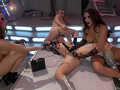 Four bitches get naked for a crazy sex session. A girl laying down on the floor is the pleasure subject of other three naughty lesbians. They get complete control over her pussy and ass. The game involves playing with a vibrator and sitting on her face. See them having fun and get really rough