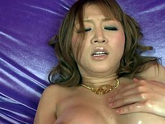 Voracious Asian bombshell Yuki Touma smears her big boobs and thick ass with oil. Curvy babe strokes her hairy meaty pussy and fondles her clit with high powered vibrator.