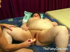 A horny fatty sucks on a dildo on the bed and makes it perfectly wet for her old cunt. She sticks it deep inside and knows how to experience some deep orgasms.