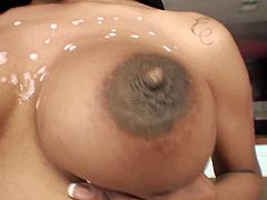 Alluring caramel cutie screams with orgasm while riding fat BBC like a cowgirl. After getting hammered by black hose in sideways and doggy poses cutie takes massive load of black jizz on her natural C cup rack.