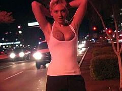 A beautiful blonde girl walks in the street at night. She pulls down a t-shirt and shows her boobies. In addition Alison shows her nude body against the background of the city lights.