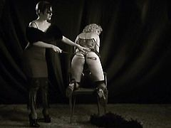 This nympho has clearly been a bad girl and displeased her mistress. Spanking her slave's with a stick, she brings out scratches.