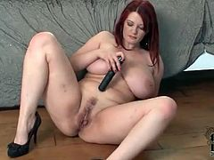 Voluptuous redhead fucks her tight pussy with a toy