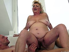 Tamara is a blonde mature with big natural tits being out by this guy stud before her wet pussy's nailed by a big cock.