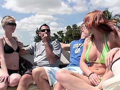 Slutty Michelle Andrews gets picked up by a man on a beach. They go somewhere by boat but can't wait and have sex right there.