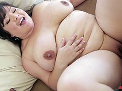 What are you waiting for? Watch this brunette BBW, with giant gazongas wearing high heels, while she goes hardcore in the missionary position.