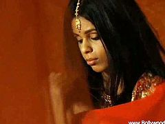 Petite Indian lady is ready for some amazing softcore action. Watch as this babe reveals her hot body and starting to dance slowly for all of her horny fans.