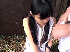 This cute Japanese slut is out in the garden and she gets down on her knees to suck his cock. She is very reluctant at first, but he eases her in by rubbing his cock all over her lips and face. Finally she puts his cock in her mouth.