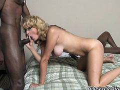 Share this with your friends! A blonde pornstar, with a nice ass and big tits, gets fucked from behind and sucks a big black dick at the same time.