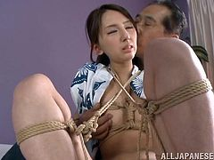 Rumi is tied up with a collection of ropes and has her panties peeled off then she has two vibrators used on her pussy at the same time.