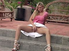 Alison Angel lifts up her skirt and masturbates outdoors