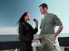 Brunette hottie Asia Carrera is getting naughty with a dude on a boat. She pleases the guy with a blowjob and then sits down on his wang and jumps on it.-