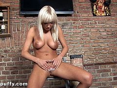 Check out Natali Blond's amazing body in this great solo scene where you'll see this beautiful blonde playing with her pink shaved pussy.