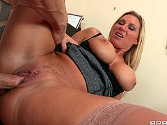 Take a look at this great hardcore scene where the sexy Devon Lee sucks on a big cock in her office before being fucked hard by it.
