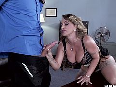 Check out this hardcore scene where the busty milf Giselle Leon is fucked by a guy with a large cock in her office.