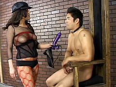 Brunette dominatrix Michelle Avanti is playing dirty games with a guy indoors. She pulls him by the hair and humiliates him and then rips his ass apart with a dildo.