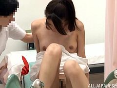 A pretty Japanese girl comes to a gynecologist to get her pussy examined. The guy fingers the chick's pink slit and then rubs it ardently with a massage dildo.