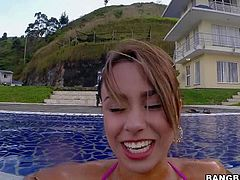 Beautiful Colombian chick Sofia in pink bikini shows off her nice boobs and round butt under water in the pool and then exposes her bare round ass under the open sky. Her sexy butt is amazing!