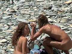 Busty with adorable ass nude babe is being watched by horny voyeur while enjoying day at the beach