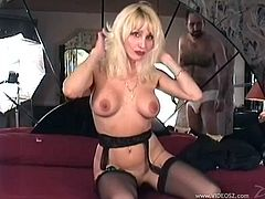 A blonde woman in stockings with garters plays with her pussy lying on a bed. Donna sits on guy's face and then gets fucked in her shaved pussy.