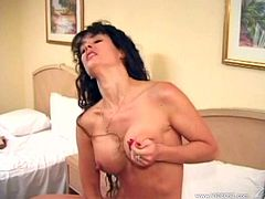Get a load of this vintage solo scene where the busty Angel Williams fingers her wet pussy as you hear her moan and watch her squirm on her bed.