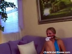 Amber Rayne and Dick Delaware fuck on the couch after bounding the blonde house owner that can only watch them having a spectacular and hot time together.